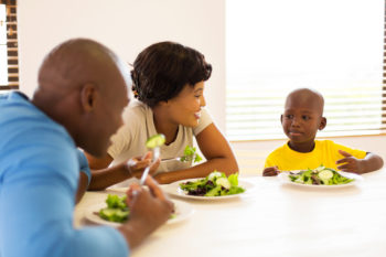 african family enjoying a healthy meal together